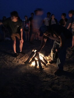 campfires at night along the beach