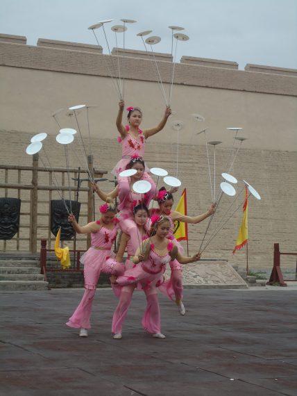 girls juggling porcelain dishes
