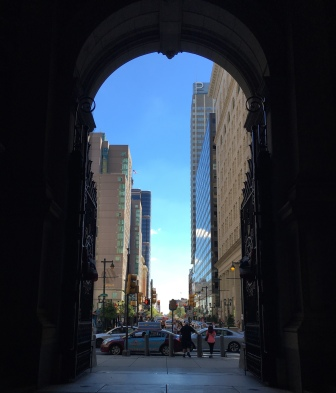 looking out from under the arches of city hall