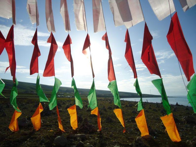 Tibetan Buddhist prayer flags waving in the air.
