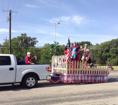 fourth of july parade -- where businesses and organizations parade around the park in their own cars