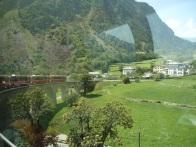 The Bernina Express slowly crawls along the countryside.