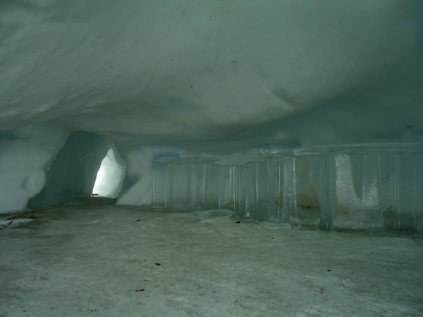 We were hiking when we noticed holes in the snow. Upon closer inspection, it was an igloo hotel! Here's the lobby/bar area.